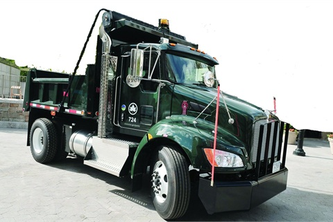 The New York City Park Department uses 17 Kenworth T370 hybrids — eight have rack bodies with liftgates, and the rest feature 5-yard dump bodies.
