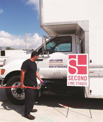 Ross Montalbano, fleet personnel with Hollywood Trucks, fills a truck with biodiesel. SLCFP, Golden Leaf Energy and Hollywood Trucks worked together to make film production in the Bayou State greener.