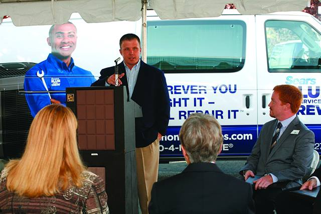 Todd Mouw, vice president, sales and marketing for ROUSH CleanTech speaks from the podium at the launch of Sears' 27 new propane-autogas vans.