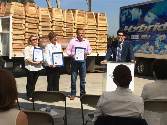 A ceremony celebrated the 2,000th recipicent of HVIP's voucher program: (l to r) Marcie Rodriguez, Redwood Products, Barbara Riordan, CARB, and Hicidro Campa, Rush Truck Centers