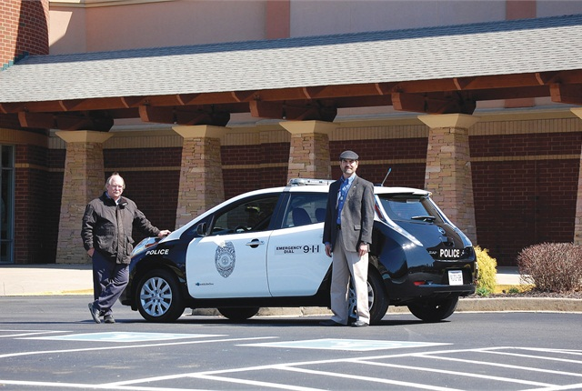 Jonathan Overly, executive director of ETCleanFuels (right), with the Kingsport, Tenn., Police Department Nissan LEAF, one of the various alternative-fuel vehicles in the City fleet, which also boasts 50 pieces of equipment powered by propane autogas. Photo courtesy of the East Tennessee Clean Fuels Coalition.