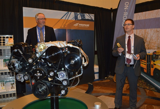 Michael Taylor, PERC's director of autogas business development (left), and Jeremy Lessaris, Power Solutions International (PSI)'s global director of marketing, present PSI's 8.8-liter propane engine at PERC's exhibit. Photo by Amy Winter.