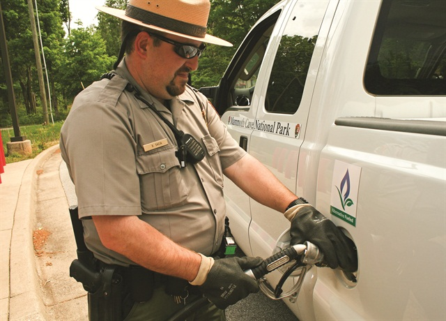 Brian Sacia, a Mammoth Cave National Park ranger, refuels one of the park's propane-powered F-250 pickup trucks.