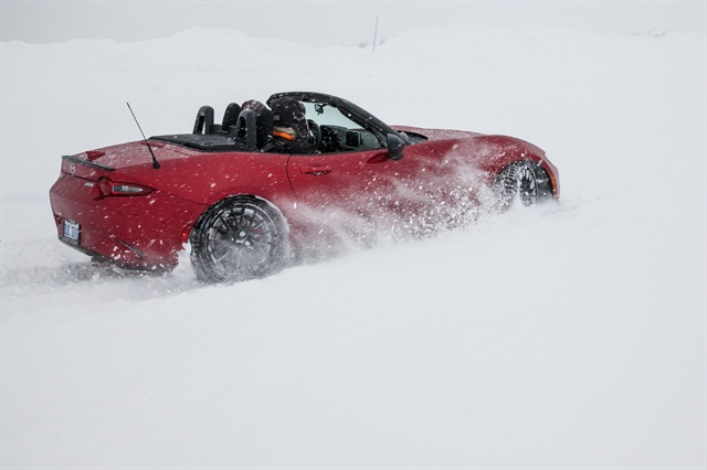 Driving a slalom with traction control turned off in a convertible MX-5 with the top down.
