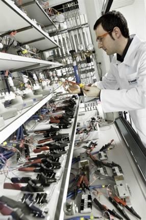 BASF lab technician Christian Saffert tests various lithium-ion batteries.