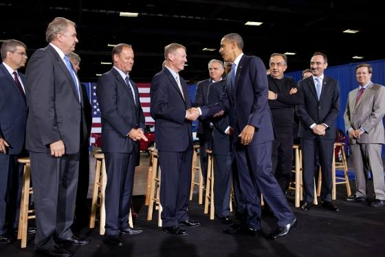 President Obama greets Ford CEO Alan Mulally and other auto industry leaders following his CAFE announcement.