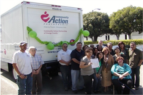 The Community Action Partnership of Orange County (CAPOC) poses with new CNG-fueled, 16-foot box truck.Photo Credit: Clean Transportation Funding from the Mobile Source Air Pollution Review Committee (MSRC)
