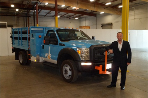EVI CEO Ricky Hanna with the EVI's Class 5 E-REV bucket truck in flatbed configuration.