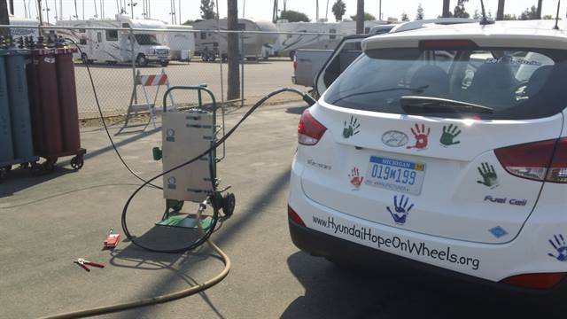The Hyundai FCEV Tucson stops to fuel up during Drive 4 Hope.