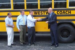 Cook-Illinois Corp. recently purchased 20 new Blue Bird Propane-Powered Vision school buses. Pictured (l-r) are Anthony Benish, John Knoelke, and John Benish Jr. of Cook-Illinois and John Kwapis of Blue Bird.Photo courtesy Blue Bird.