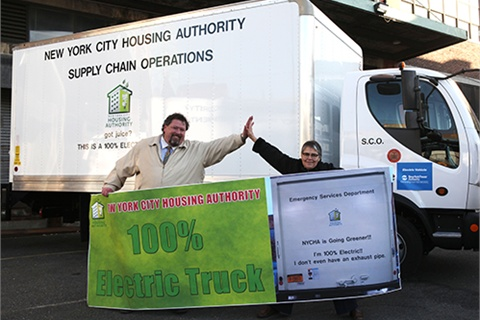 Shaun Hession, deputy director of general services for NYCHA, and Margarita López, environmental coordinator for NYCHA, celebrate the addition of electric trucks to the agency's fleet.