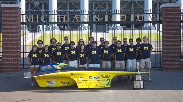 The Solar Car Team at the University of Michigan with the National Championship Trophy from the American Solar Challenge. Photo credit: Aaron Frantz