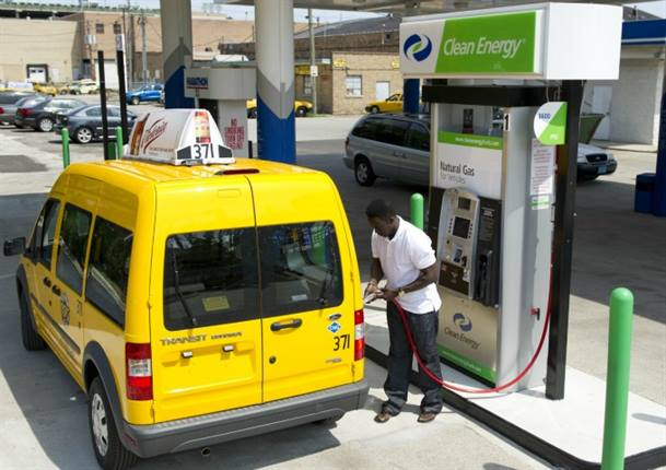 A Transit Connect Taxi, fueled by CNG, fills up in Chicago.