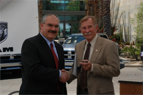 Yuma Mayor Al Krieger (right) takes the keys to a Ram 1500 plug-in hybrid electric pickup from Chrysler Group's Abdullah Bazzi‎.