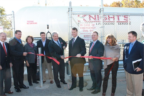 (L-R): Stephen Russell, program coordinator of Massachusetts Clean Cities; Tom Hogan, general manager of Knight's Airport Limousine Service; Barbara Clifford, president of Corridor Nine Chamber of Commerce; Rep. Matthew Beaton; Michael F. Hogan, president of Knight's Airport Limousine Service cuts the ribbon; Senator Michael O. Moore; Tim Murray, president of Worcester Chamber of Commerce; Jeannie Herbert, president of the Blackstone Valley Chamber; Todd Mouw, vice president of sales and marketing for ROUSH CleanTech.