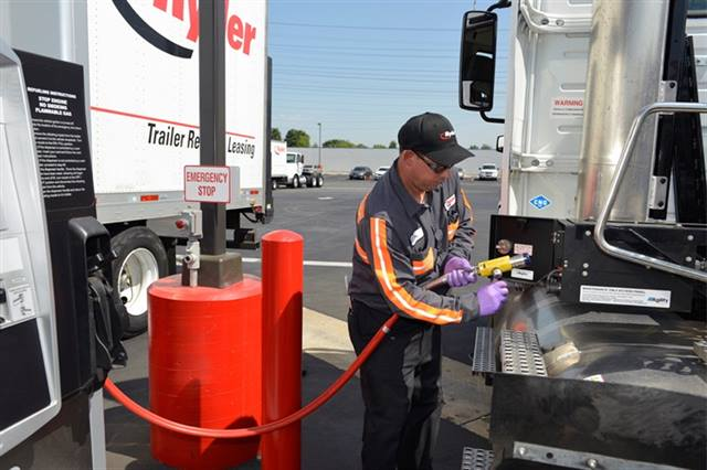 A Ryder technician fuels a CNG vehicle at Ryder's new natural gas fuel station in Fontana, Calif.Photo Credit: Ryder
