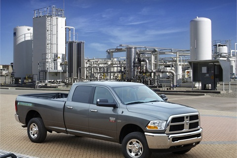 The bi-fuel pickup truck uses natural gas as its primary fuel and will automatically switch to gasoline when the CNG tanks are empty.