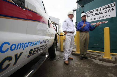 The CEOs of Chesapeake Energy and U.S. Steel help launch a new CNG station. Photo/U.S. Steel
