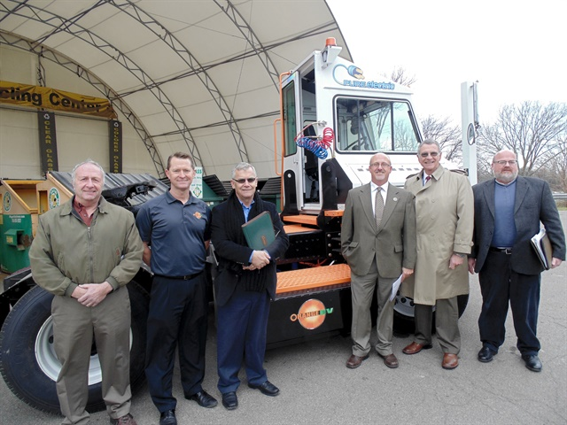 Chautauqua County officials and Orange EV representatives pose with