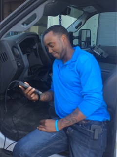 Jonathan Ford, fleet management superintendent, installs the technology in a fleet vehicle. Photo courtesy of City of Orlando