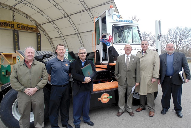 Chautauqua County officials and Orange EV representatives pose with the county's new Orange EV terminal truck. Photo courtesy of Orange EV