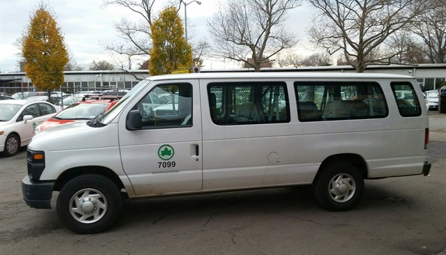 New hybrid vans will replace these older 15-passenger gasoline vans. Photo courtesy of NYC Parks
