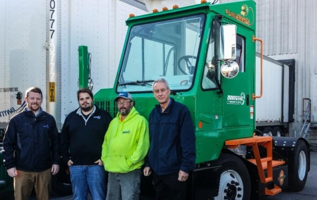 Innovative Transportation Services (ITS) stands with their new Orange EV T-Series pure-electric terminal truck. (L-R) Bill Loupee, VP of both ITS and TCS (Transportation and Consolidation Services, Inc.); James Hotnich, dispatch manager; Owen Owens, driver; and Dave Harper, president of ITS. (Photo courtesy of Orange EV)