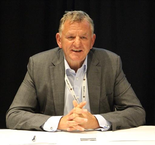 Andreas Renschler, head of Volkswagen Truck & Bus, talks to reporters at the NACV show Monday. Photo: Evan Lockridge