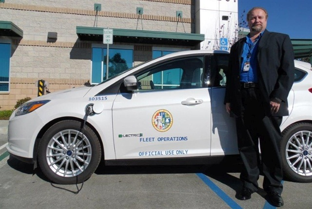 Fleet Manager Pete Bednar is pictured here with one of the county's electric vehicles. Photo courtesy of Ventura County