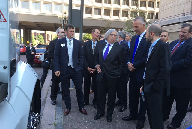 U.S. Energy Secretary Ernest Moniz gets a closer look at the SuperTruck. Photo by Jim Park