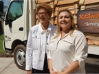(l. to r.) CARB Member Barbara Riordan and Marcie Rodriguez of Redwood Products, Inc stand in front of hybrid delivery truck that was awarded the 2,000th heavy-duty clean vehicle voucher incentive. Photo courtesy of CARB.
