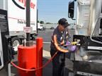 A Ryder technician fuels a CNG vehicle at Ryder's new natural gas fuel station in Fontana, Calif.<br />Photo Credit: Ryder