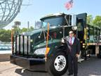 Keith Kerman, assistant commissioner for the New York City Parks Department, is shown with one of the department's 17 Kenworth T370 diesel-electric hybrid trucks. (Photo: Kenworth)