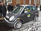 Indiana Governor Mitch Daniels drives the THINK City car during a vehicle presentation Dec. 16 at Fort Harrison State Park outside of Indianapolis.