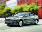 HYBRID Among the Ford Fusion Hybrid s updated features is a SmartGauge