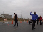 Natalie Weimer, XL Hybrids, launches an apple into the parking lot of