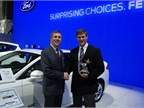 Wolski and Michon pose in front of the Ford Fusion Energi, which won