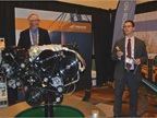 Michael Taylor, PERC's director of autogas business development (left), and Jeremy Lessaris, Power Solutions International (PSI)'s global director of marketing, present PSI's 8.8-liter propane engine at PERC's exhibit.