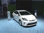 A 2014 Toyota Prius hybrid is pluggd into its charging station.