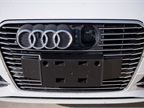 The charging port is hidden behind the  four rings  logo on the